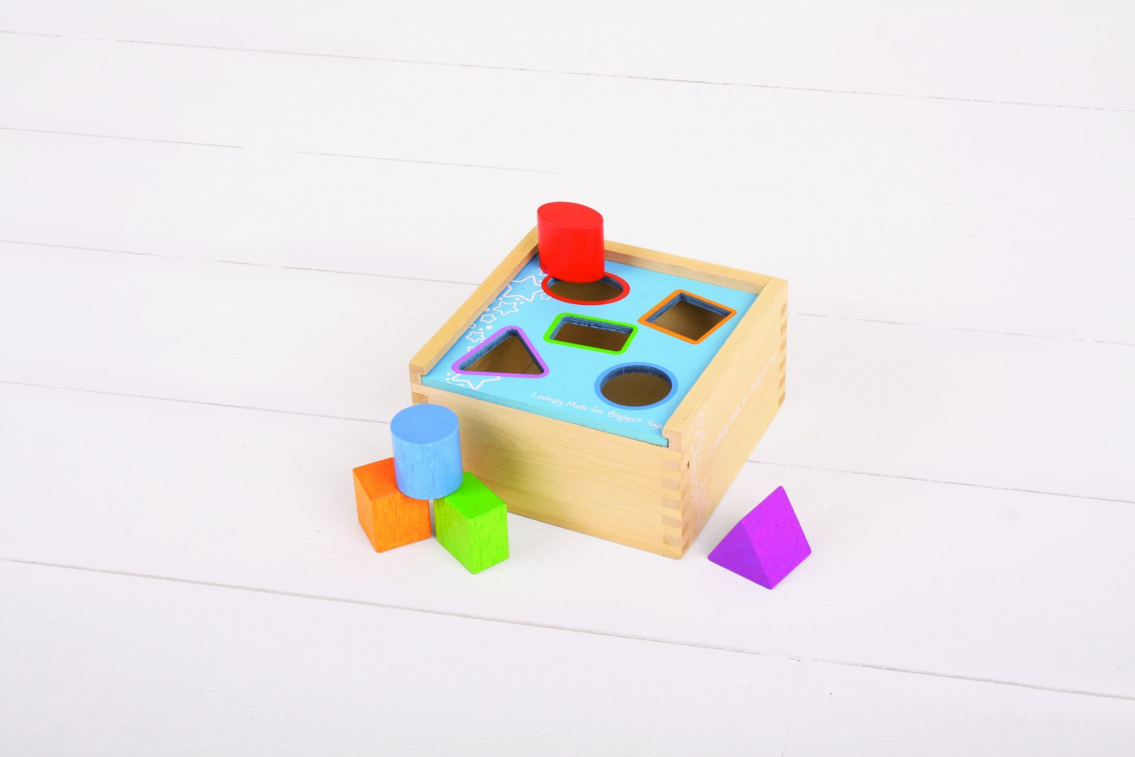 Dřevěná motorická vhazovací hračka - Krabička s tvary
