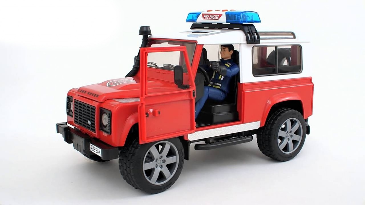 Bruder - Hasičské auto Land Rover s figurkou