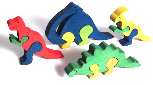 Fauna Dřevěné vkládací puzzle z masivu sada dinosauři 4 ks